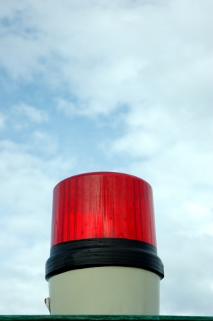 red siren: a red siren lights with blue sky background
