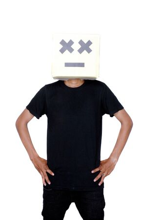 young boy standing with his face from cardboard boxes against white background photo