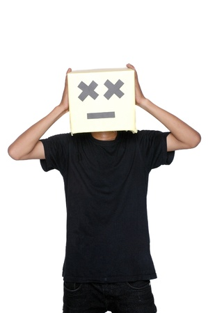 young boy hold his head on his face from cardboard boxes against white background Stock Photo - 17726183