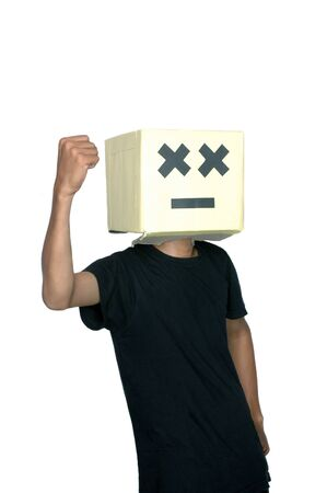 young boy clenched his right hand with his face from cardboard boxes against white background Stock Photo - 17726241