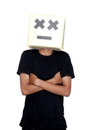 young boy standing with his face from cardboard boxes against white background Stock Photo - 17726185