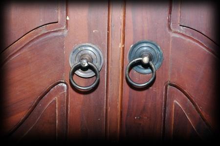 dark brown wooden door with iron knocker Stock Photo - 18211580