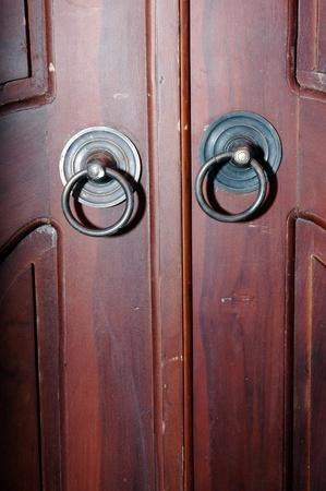 dark brown wooden door with iron knocker photo
