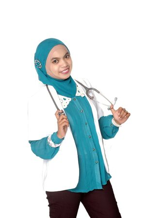 portrait of Asian young woman doctor on white background photo