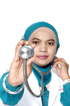 Asian young woman doctor holding a stethoscope on white background photo