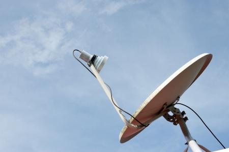 parabolic dish antenna against blue sky Stock Photo - 18573318
