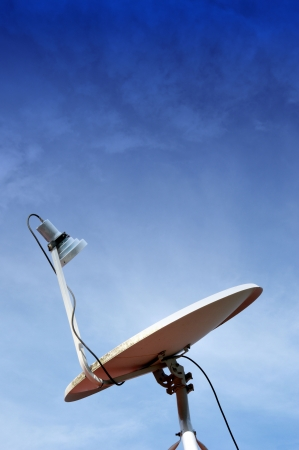 parabolic dish antenna against blue sky Stock Photo - 18573309
