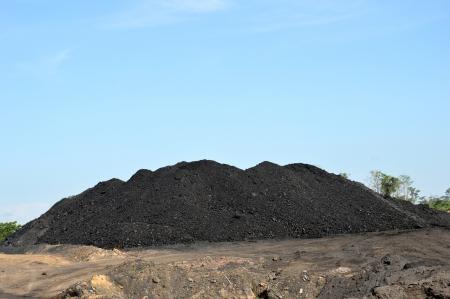 coal dunes against blue sky Stock Photo - 19134998
