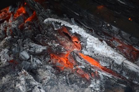 embers on firewood Stock Photo