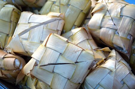 compressed rice: ketupat, Indonesian traditional food which is rice steamed in coconut leaves