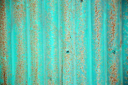 corrugated iron: old green zinc wall
