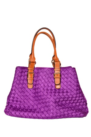 purple handbag on white background photo
