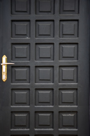 new black wooden doors at a building photo