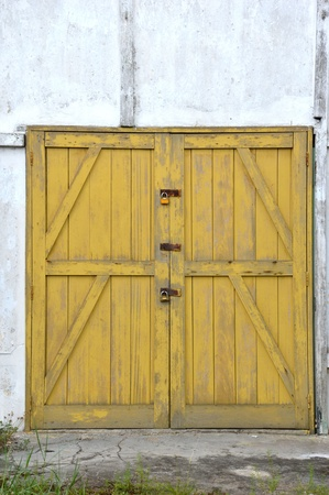old yellow wooden doors on a barn Stock Photo - 20944526