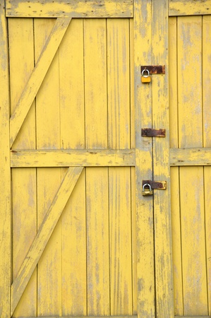 old yellow wooden doors on a barn Stock Photo - 20944528