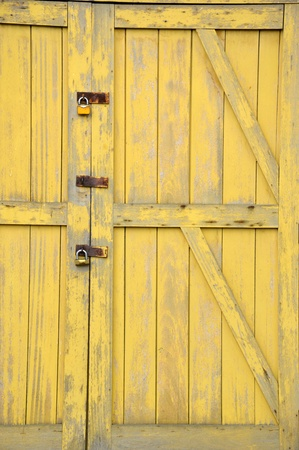 old yellow wooden doors on a barn Stock Photo - 20944538