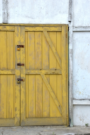 old yellow wooden doors on a barn Stock Photo - 20944541