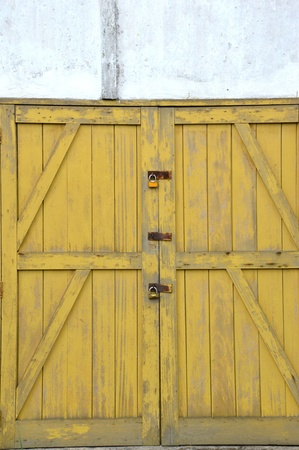 old yellow wooden doors on a barn Stock Photo - 20944556