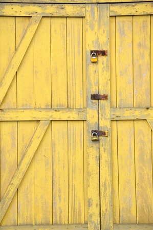 old yellow wooden doors on a barn Stock Photo - 20944557