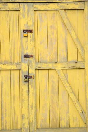 old yellow wooden doors on a barn Stock Photo - 20944564