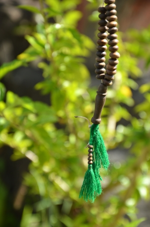 brown rosary against nature background photo