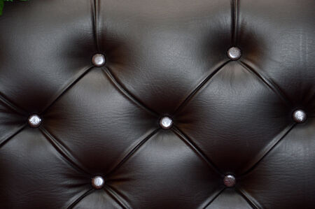 texture and pattern of black leather seat upholstery photo