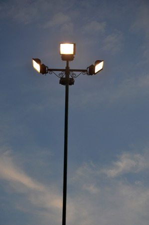 four park light poles in dusk photo