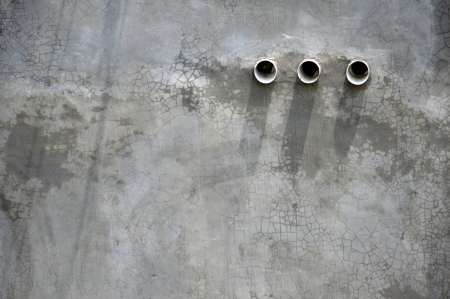 three air holes in the cement wall Stock Photo - 22880938