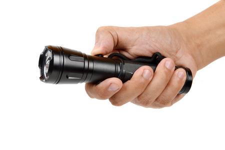 hand holding a black flashlight isolated on white background