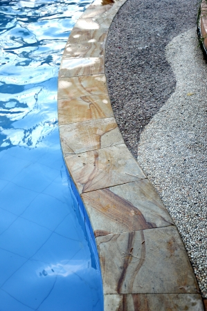ceramic shape with blue water in the pool photo
