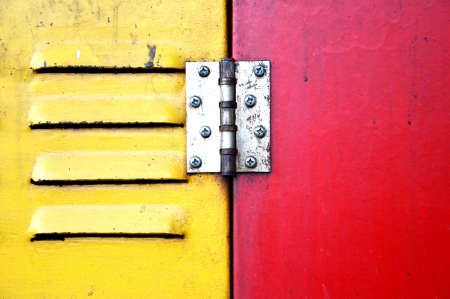 air hole: red and yellow iron door with air hole
