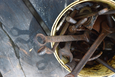 old tools in a bucket
