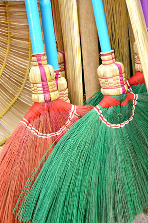 bright housekeeping: detail texture and pattern of green and red broom fibers Stock Photo