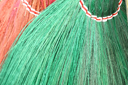 detail texture and pattern of green and red broom fibers photo