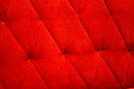 texture and pattern of red velvet seat upholstery photo