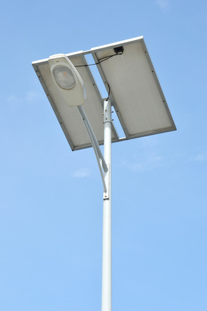 sustainable design: street lights with solar panels against blue sky Stock Photo