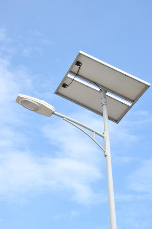 street lights with solar panels against blue sky photo
