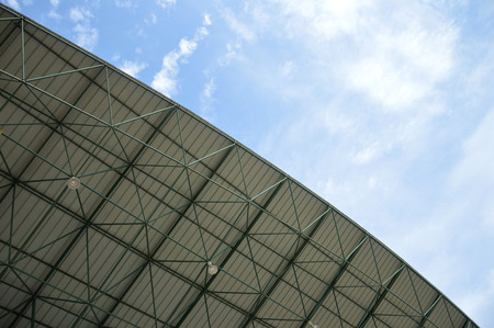 floodlit: stadium roof against the sky