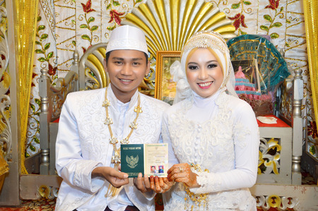 Indonesian bridal couples were undergoing the marriage ceremony event