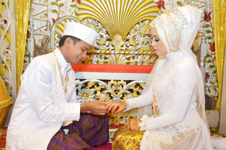 Indonesian bridal couples were undergoing the marriage ceremony event photo