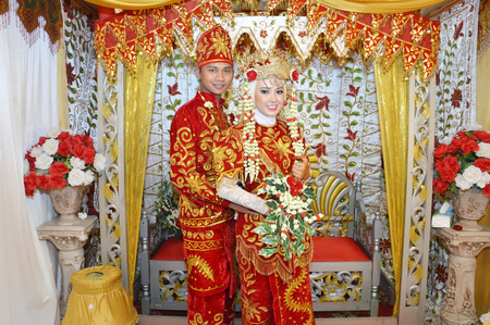 Indonesian bridal couples were dressed in traditional red banjarnese costume photo