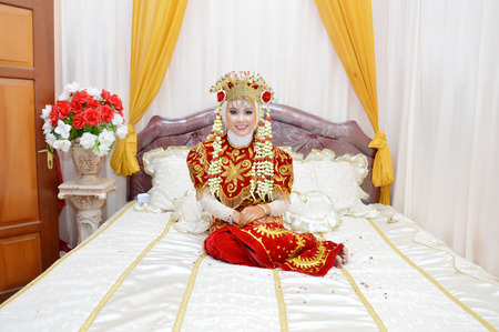 Indonesian bridal couples were pose in their room photo