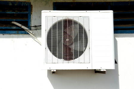 conditioned: old air conditioner on the wall