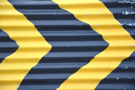 black and yellow strips on the iron wall photo