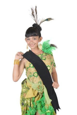 dressing up: portrait of asian teenage girl dressing up in green kebaya modification on white background