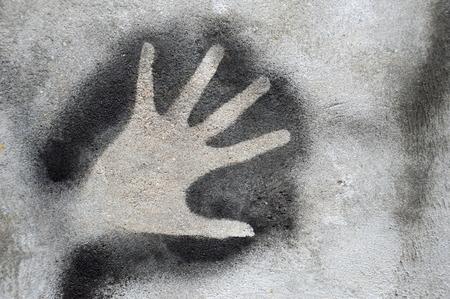 revolt: hand graffiti on the wall Stock Photo