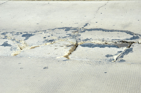 cracked concrete: cracked concrete road