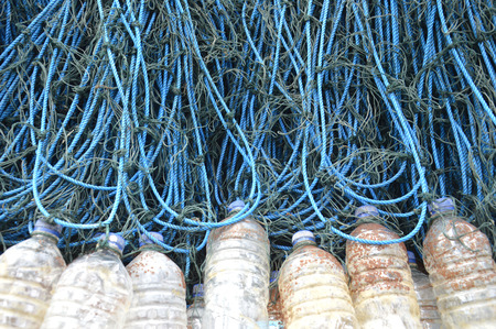 bretagne: fishing nets with used plastic bottle as floater