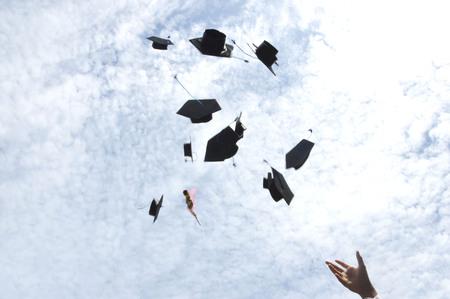 graduates hat thrown into the sky photo