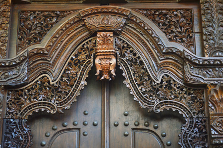 wooden window with traditional Jepara carving ornaments